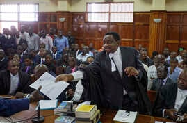 Opposition lawyer and party official James Orengo hands a letter informing him that his own passport has been suspended by the government, to the judge in the case of opposition politician Miguna Miguna, at the High Court in downtown Nairobi, Kenya,