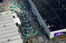 FILE - An aerial photo shows Boeing 737 Max airplanes parked on the tarmac at the Boeing factory in Renton, Wash., March 21, 2019.