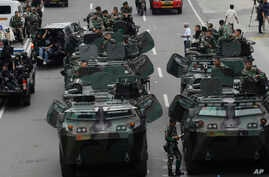 Indonesian soldiers man armored vehicles as they guard near the site where an attack occurred in Jakarta, Jan. 14, 2016.
