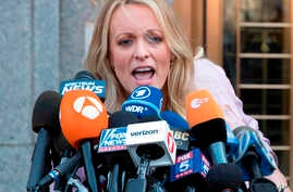 FILE - Adult film actress Stormy Daniels addresses reporters outside federal court in New York,April 16, 2018.