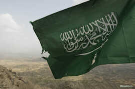 In this file photo, Saudi Arabia's national flag is seen at the Khoba frontline border with Yemen January 27, 2010. REUTERS/Fahad Shadeed