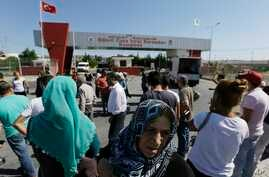 FILE - Relatives and friends of prisoners wait outside a high security prison complex in Silivri, about 80 kilometers (50 miles) west of Istanbul, Aug. 18, 2016.