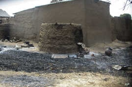 FILE: In this photo taken on Friday, Jan. 31, 2014, a burned  house is pictured following an attack by gunmen, in Wada Chakawa, Yola, Nigeria.