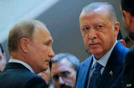 Russian President Vladimir Putin (L) and Turkish President Recep Tayyip Erdogan prepare to enter a hall for their talks at the Bocharov Ruchei residence, in Sochi, Russia, Sept. 17, 2018.