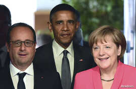 French President Francois Hollande (L), U.S. President  Barack Obama and Germany's Chancellor Angela Merkel arrive for the second working session of a G7 summit at the Elmau castle in Kruen near Garmisch-Partenkirchen, Germany, June 8, 2015.