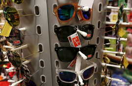 FILE - Counterfeit sunglasses are displayed at customs headquarters in Hong Kong, China, Aug. 6, 2015.