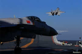 A live-fire drill using a Chinese aircraft carrier and jets is carried out in the Bohai sea, China, Dec. 14, 2016.