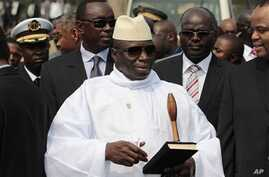 Gambian President Yahya Jammeh stands outside the Sipopo Conference Center ahead of the opening session of the 17th African Union Summit, in Malabo, Equatorial Guinea, June 2011. (file photo)
