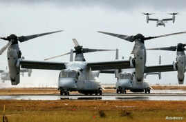 Four Ospreys from the U.S. Navy Ship (USNS) Charles Drew prepare to taxi on the tarmac of Tacloban airport in the aftermath of super typhoon Haiyan November 14, 2013.c