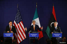 Libyan prime minister-designate Fayez al-Sarraj (L-R), U.S. Secretary of State John Kerry and Italian Foreign Minister Paolo Gentiloni attend a news conference in Vienna, Austria, May 16, 2016.