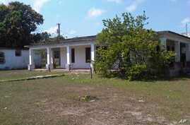 This Friday, March 20, 2105 photo shows the house that used to belong to U.S. citizen Daniel Smith in the Isle of Pines, Cuba. The property was confiscated by the new Cuban government after the revolution.