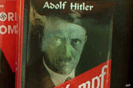 "FILE - A book store displaying Adolf Hitler's ""Mein Kampf"" in downtown Sarajevo. With the expiration of a 70-year copyright hinged on the 1945 suicide death of the anti-Semitic ruler, the manuscript enters the public domain."