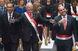 Peru's President Pedro Pablo Kuczynski, center, walks with Prime Minister Fernando Zavala, right, and first Vice President Martin Vizcarra, left, to Congress in Lima, Peru, July 28, 2017.  Kuczynski delivered his first State of the Nation address to