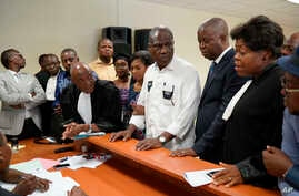 Accompanied by his wife and his lawyers, Congo opposition candidate Martin Fayulu, center, petitions the constitutional court following his loss in the presidential elections in Kinshasa, Congo, Saturday Jan. 12, 2019.