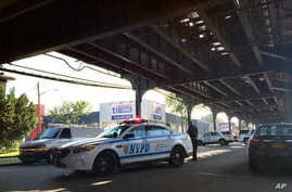 New York City police secure the scene where two men were shot as they left prayers at a mosque
