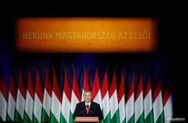 "Hungarian Prime Minister Viktor Orban delivers his annual state of the nation speech in Budapest, Hungary, Feb. 18, 2018. Slogan reads ""For us, Hungary first!"""