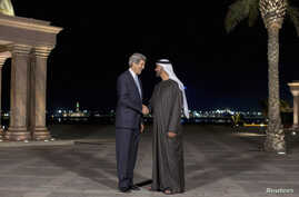 U.S. Secretary of State John Kerry (L) speaks to Abu Dhabi's Crown Prince Sheikh Mohammed bin Zayed al-Nahyan before their meeting at the Emirates Palace in Abu Dhabi, March 4, 2013.