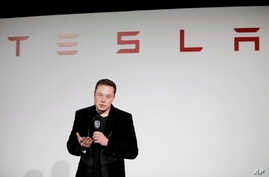 FILE - Elon Musk, CEO of Tesla Motors Inc., talks during a news conference at the company's headquarters in Fremont, California, Sept. 29, 2015.