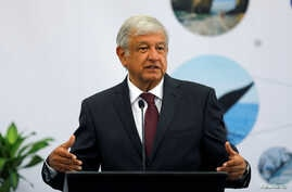 Leftist front-runner Andres Manuel Lopez Obrador of the National Regeneration Movement, gestures during the 16th National Tourism Forum at the Chapultepec Castle in Mexico City, Mexico, May 7, 2018.