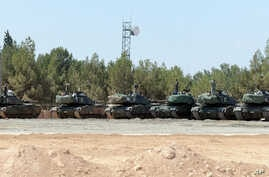 """FILE - Turkish tanks stationed near the Syrian border, in Karkamis, Turkey, Sept. 3, 2016. Turkey's state-run news agency says Turkish tanks have entered Syria's Cobanbey district northeast of Aleppo in a """"new phase"""" of the Euphrates Shield operation"""