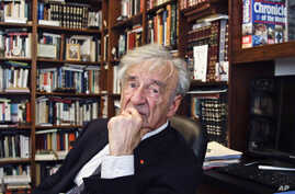 FILE - In this Sept. 12, 2012,  photo Elie Wiesel is photographed in his office in New York.  Wiesel, the Nobel laureate and Holocaust survivor has died.  His death was announced Saturday, July 2, 2016  by Israel's Yad Vashem Holocaust Memorial.