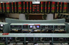 Traders wait for the start of the morning session at the Istanbul Stock Exchange in Istanbul, Turkey, Monday, March 9, 2009.