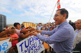 Peruvian President Martin Vizcarra visits flood victims in the northern city of Piura, Peru, March 27, 2018.