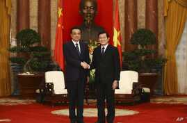 Chinese Premier Li Keqiang, left, with Vietnamese President Truong Tan Sang, Presidential Palace, Hanoi, Oct. 14, 2013.
