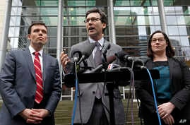 Attorney General Bob Ferguson, center, stands with Solicitor General Noah Purcell, left, and Civil Rights Unit Chief Colleen Melody as he speaks with media members on the steps of the federal courthouse after an immigration hearing there, March 15, 2...