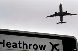 FILE - A plane takes off over a road sign near Heathrow Airport in London, June 5, 2018.
