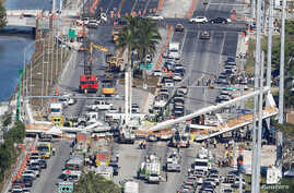 FILE - Aerial view shows a pedestrian bridge collapsed at Florida International University in Miami, March 15, 2018.
