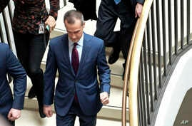 President Donald Trump's former campaign manager Corey Lewandowski, center, arrives on Capitol Hill in Washington, Jan. 17, 2018, where his is expected to be interviewed by the House Intelligence Committee regarding the Russia probe.