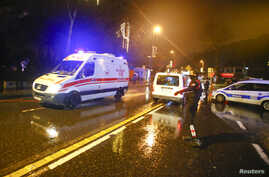 An ambulance arrives near a nightclub where a gun attack took place during a New Year's party in Istanbul, Turkey, Jan. 1, 2017.
