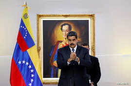 Venezuela's President Nicolas Maduro greets the international observers for the May 20 election at the presidential palace in Caracas, May 18, 2018.