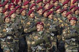 FILE - Indian Special Forces commando G. D. Singh shouts as he leads his battalion during the Republic Day parade in New Delhi.