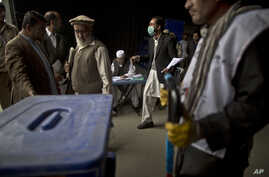 Afghan election workers prepare ballot boxes and election materials to be loaded into trucks and delivered to polling stations, at a warehouse in Kabul, Afghanistan, April 3, 2014.