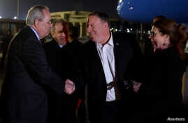 U.S. Secretary of State Mike Pompeo and his wife, Susan, are greeted by Assistant Foreign Minister For North and South American Affairs Reda Habeeb Ibrahim Zaki and Charge d'Affaires for the U.S. Embassy in Egypt, Tom Goldberger, as they arrive at Ca
