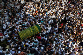 Mourners carry the coffin of Ko Ni, prominent Muslim lawyer who was shot dead, at the Muslim cemetery in Yangon, Myanmar, Jan. 30, 2017.
