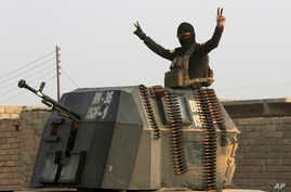 A member of Iraq's elite forces flashes a victory sign as forces advance toward Islamic State positions in the village of Tob Zawa, near Mosul, Iraq, October 25, 2016. In Columbus, Ohio, Monday, November 7, 2016, Aaron Daniels was accused of trying t