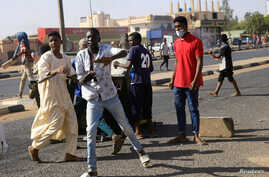 Sudanese demonstrators take part in an anti-government protests in Khartoum, Sudan, Jan. 25, 2019.