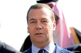 Russian Prime Minister Dmitry Medvedev is seen in a group photo during the second day of the international conference on Libya in Palermo, Italy, Nov. 13, 2018.