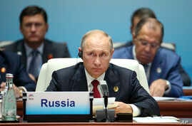 Russian President Vladimir Putin is seen attending the Dialogue of Emerging Market and Developing Countries on the sideline of the BRICS Summit in Xiamen, China, Sept. 5, 2017.
