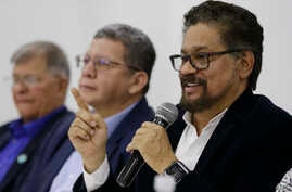 Ivan Marquez, a former leader of the Revolutionary Armed Forces of Colombia, FARC, announces that the group's onetime top commander, Rodrigo Londono, will run for president in next year's election, during a press conference in Bogota, Colombia, Nov.
