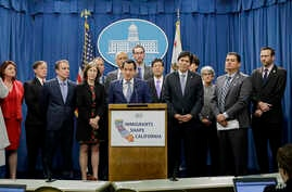 Assembly Speaker Anthony Rendon, D-Paramount, center, discusses a pair of proposed measures to protect immigrants, during a news conference in Sacramento, Calif., Dec. 5, 2016.