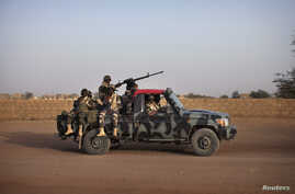 Malian soldiers patrol the streets of Gao, February 20, 2013.
