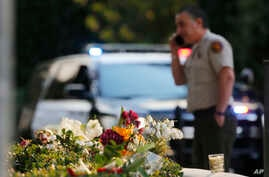 A bouquet left by mourners lies near the site of Wednesday's mass shooting in Thousand Oaks, Calif., Nov. 9, 2018.