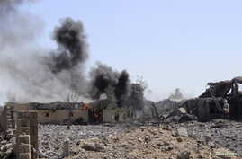 Smoke billows from a storage building belonging to the education ministry's printing press corporation after it was hit by a Saudi-led airstrike in Yemen's northwestern city of Saada, June 2, 2015.
