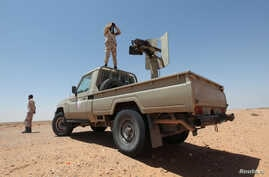 FILE - Libyan forces allied with the UN-backed government patrol to prevent Islamic State resurgence on the outskirts of Sirte, Libya, Aug. 4, 2017.