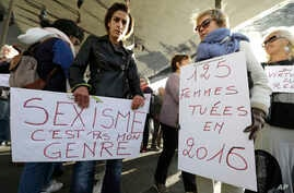 "Women hold placards reading ""Sexism is not my gender,"" left, and ""125 women killed in 2016"" during a rally protesting sexual abuse and harassment, in Marseille, southern France, Oct. 29, 2017."