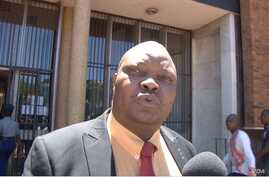 """Job Sikhala, the lawyer for former foreign affairs minister Walter Mzembi, talks to reporters after court proceedings where he said charges against his client were """"really ridiculous,"""" in Harare, Zimbabwe, Jan 6, 2018. (S. Mhofu/VOA)"""